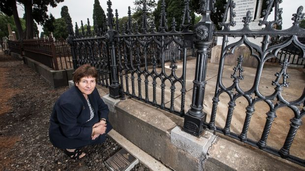 Dr Celestina Sagazio at the Melbourne General Cemetery with the plaque in memory of Louisa Barrow.