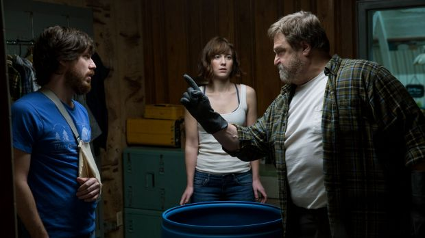 John Gallagher jnr as Emmett, Mary Elizabeth Winstead as Michelle, and John Goodman as Howard in 10 Cloverfield Lane.