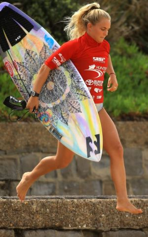 Felicity Palmateer leaps on to the beach in Newcastle during Surfest 2014.