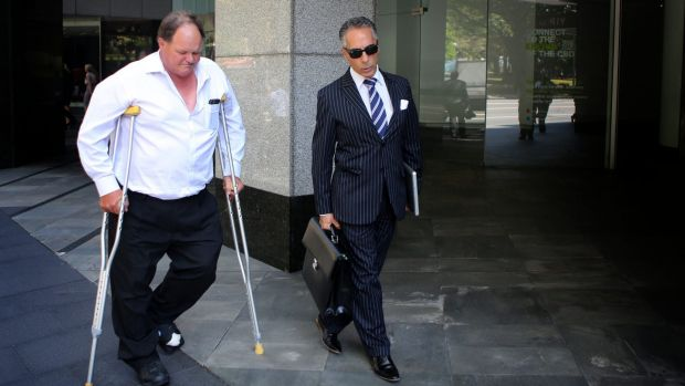 Former Botany Bay Council CFO Gary Goodman leaves ICAC on crutches during Monday's inquiry into the council.