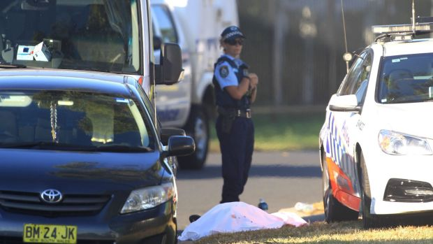 A police officer at the scene of the Ingleburn shooting, guarding what appeared to be a body.