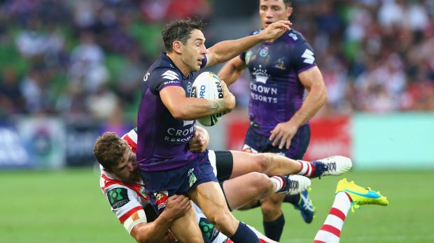 Well held: Billy Slater is tackled by Gareth Widdop and Will Matthews.