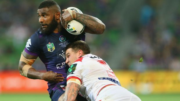 Try machine: Marika Koroibete is driven back by Josh Dugan.