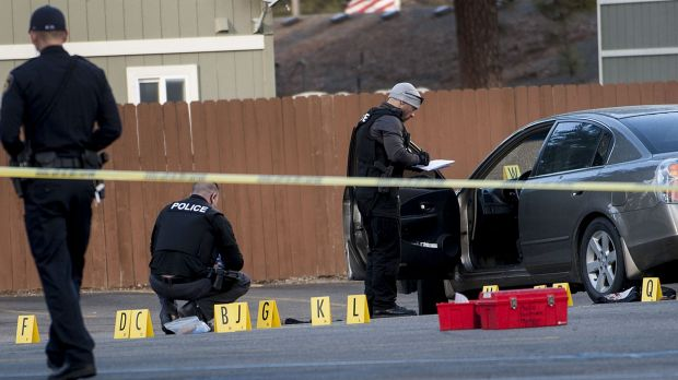 Coeur d'Alene police investigate the scene where  pastor Tim Remington was shot.