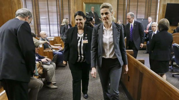 Sportscaster and television host Erin Andrews, centre, leaves the courtroom after her lawsuit was given over to the jury.