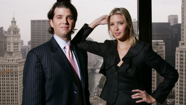 Donald Trump Jr., and his sister Ivanka Trump pose inside the Chicago offices of their father Donald Trump.