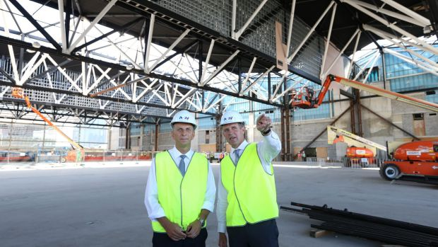 Premier Mike Baird and Infrastructure Minister Andrew Constance inspect the new roof.