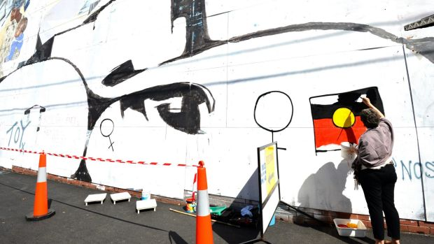 Megan Evans back at the Smith Street mural.