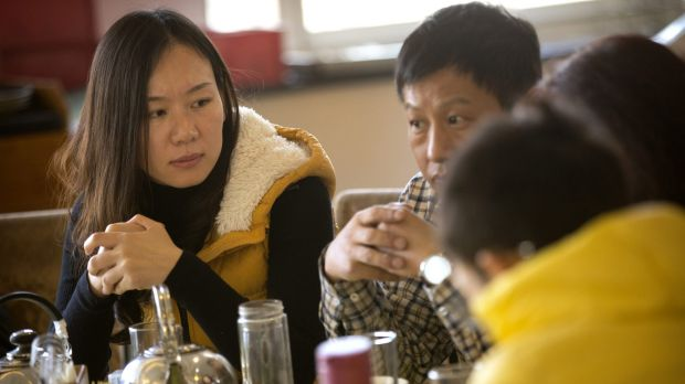 Kelly Wen, left, whose husband was aboard Malaysia Airlines flight MH370 in Beijing last month.
