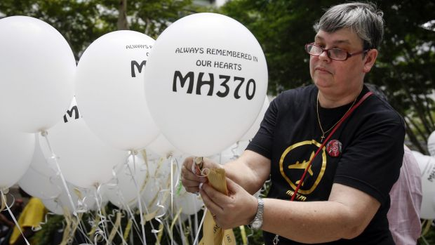 Jacquita Gomes, wife of Patrick Gomes, the in-flight supervisor on MH370, prepares balloons with names of those on board ...