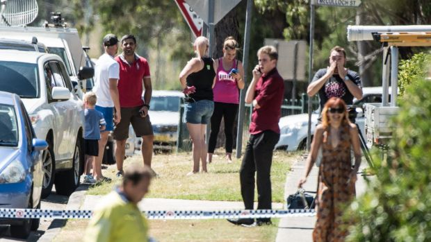 Local residents look on as police respond to an incident on Regent St in Riverstone.