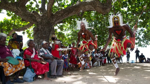 Locals watch the Neguams Dance Troup perform for the Recognise team on Mer Island in the Torres Strait. The team has ...