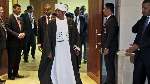 Sudan's President Omar al-Bashir leaves after a bilateral meeting with Indonesian President Joko Widodo on the sidelines ...