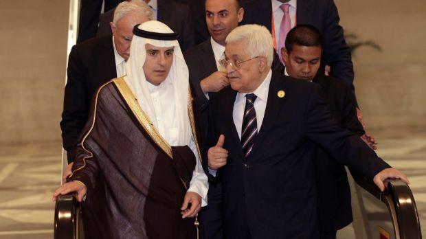 Palestinian President Mahmoud Abbas, right, talks to Saudi Arabia's Foreign Minister Adel al-Jubeir at the extraordinary ...