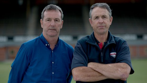 Standing firm: Neale and Terry Daniher show their committment to the Bombers.