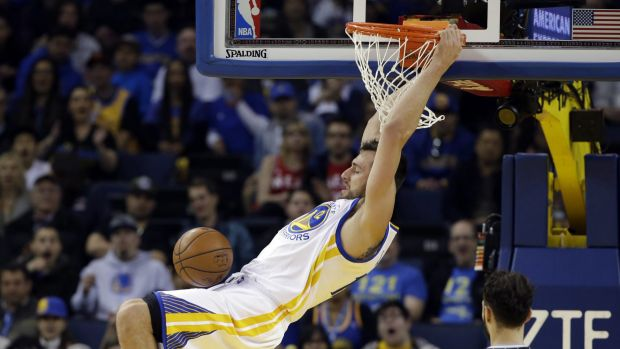 Flying high: Australian Andrew Bogut throws one down for the Warrios in their win over Orlando.
