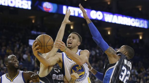 Hard work: Stephen Curry and the Golden State Warriors had to earn their NBA-record 45th consecutive home win.