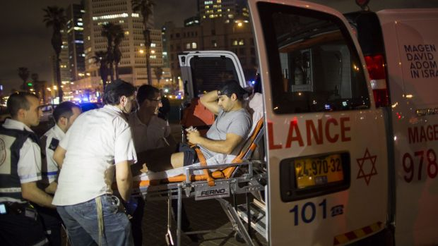 A wounded man is evacuated from the scene of a stabbing attack in Jaffa, a mixed Jewish-Arab part of Tel Aviv, Israel.