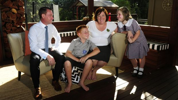 Diplomat Trudy McGowan at home Canberra with her family, from left, Justin, Will,12 and Genevieve,9. She was a primary ...