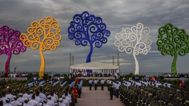Soldiers stand before President Daniel Ortega of Nicaragua at an event to celebrate the 36th anniversary of the ...