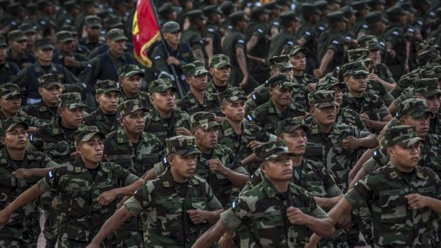 Soldiers march at an event to celebrate the 36th anniversary of the constitution of the country's air force in Managua.
