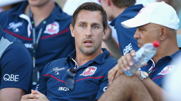 Bystander: Suspended Roosters player Mitchell Pearce watches on the from stand during the round one NRL match against ...