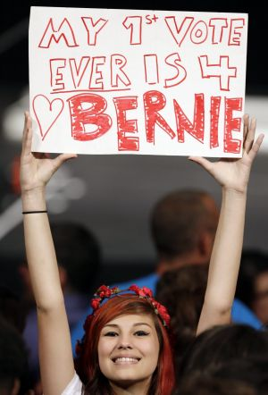 Lauren Esquivel displays a sign supporting Democratic presidential candidate Bernie Sanders in Miami on Tuesday.