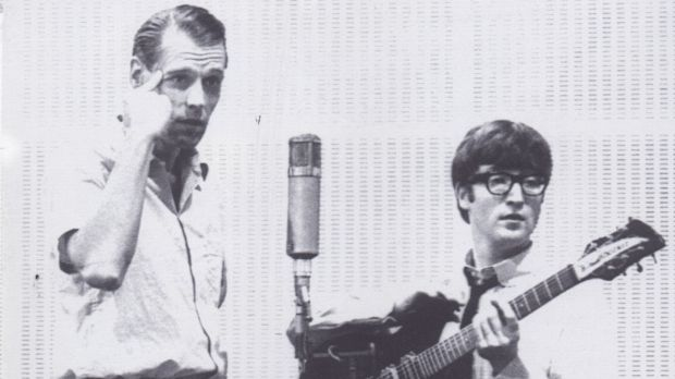 Producer George Martin with John Lennon in the 1960s.