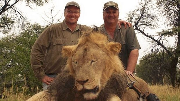 Walter Palmer (left) poses with the corpse of Cecil the lion after hunting him with his bow, wounding the leader of the ...