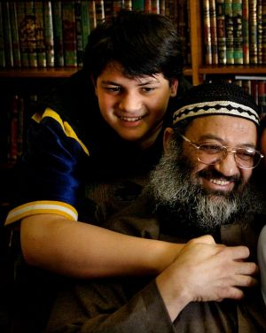 Ayman Omran photographed as a 13-year-old with his father Sheik Mohammed Omran in 2003.