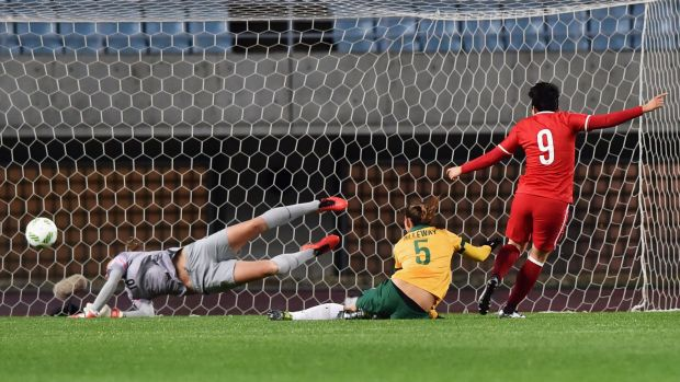 Ma Xiaoxu opens the scoring by heading past Australian keeper Mackenzie Arnold.