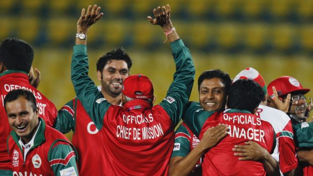 Top debut: Oman's team officials and players celebrate after beating Ireland.