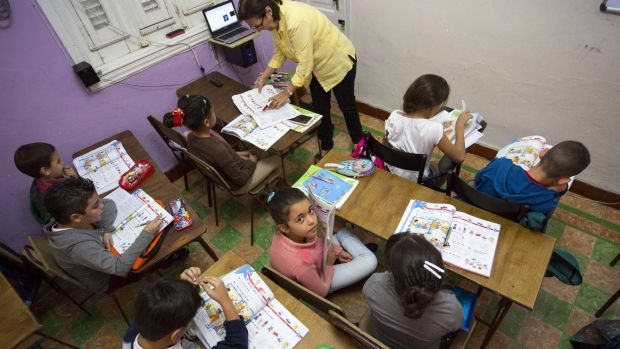Students at an English class at the Cuban School of Foreign Languages in Havana. Despite ideological and legal hurdles, ...