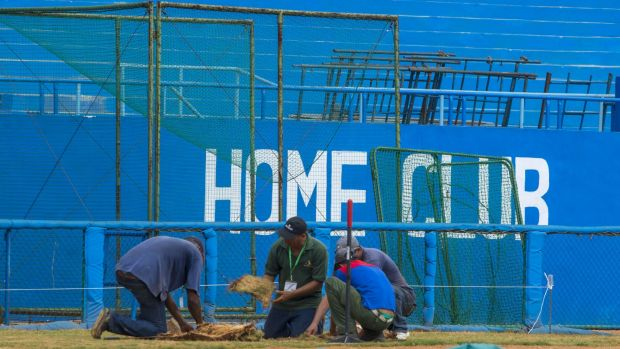 Workers replace the grass at the Latinoamericano Stadium baseball arena in Havana. Barack Obama plans to attend the ...