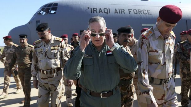 Iraqi Defence Minister Khaled al-Obeidi, centre, arrives at a military base outside Tikrit, north of Baghdad, on ...