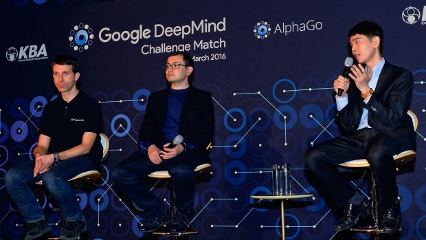 South Korean professional Go player Lee Se-dol, right, attends a press conference after the match against Google's ...