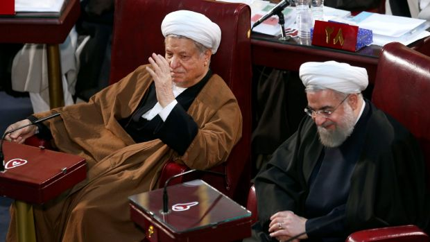 Iranian President Hassan Rouhani, right, and former president Akbar Hashemi Rafsanjani, left, who are members of the ...