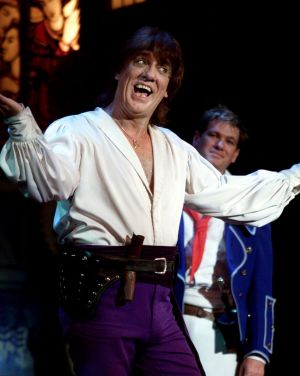 Jon English with Simon Gallaher in the background in a performance of The Pirates of Penzance.