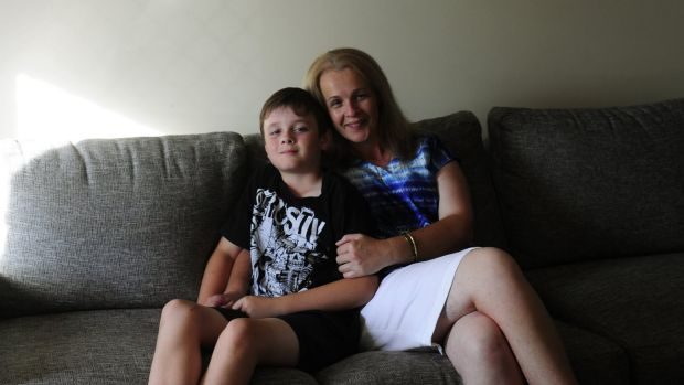 Brodie Collins and his mum, Tracey, at their family home in Harrison.