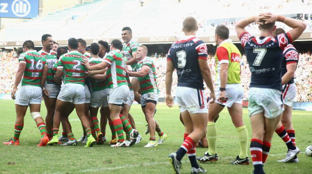 Rabbitohs run riot: South Sydney players celebrate after Hymel Hunt scored a try during the round one clash with the ...