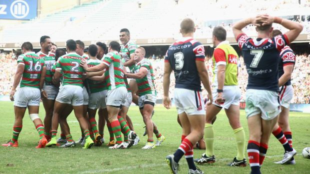 Jubilation: The Rabbitohs celebrate with Hymel Hunt after he scored a try during the round one NRL match between the ...