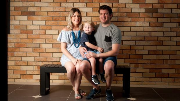 Naomi and Brad Lynn with son Mason, 2. The family bought a house with help from Naomi's dad.