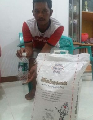 Fisherman Muhammad Hatta, who returned the asylum seekers to Indonesia, with rice and water  provided by Australian ...