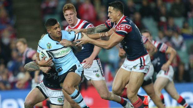 Needs a Nu phone: Fa'amanu Brown in action against the Roosters.
