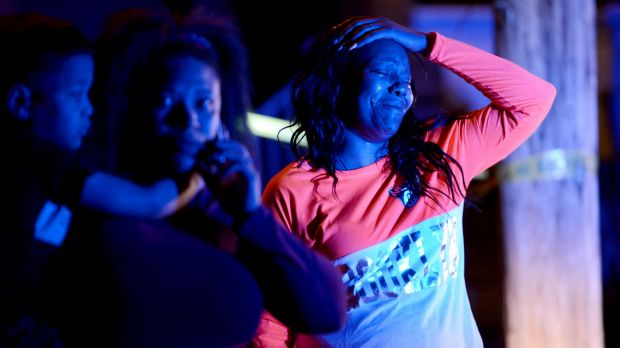 A woman reacts at the scene of the deadly shooting in Wilkinsburg.