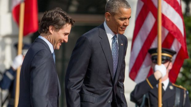 President Barack Obama and Canadian Prime Minister Justin Trudeau take the stage together during an arrival ceremony on ...