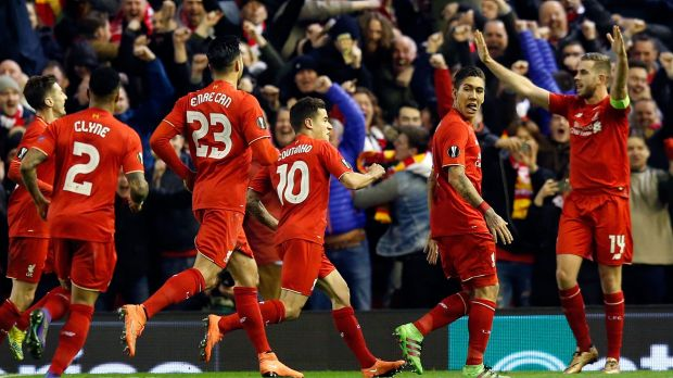 Liverpool's Roberto Firmino, second from right, celebrates after scoring his side's second goal.