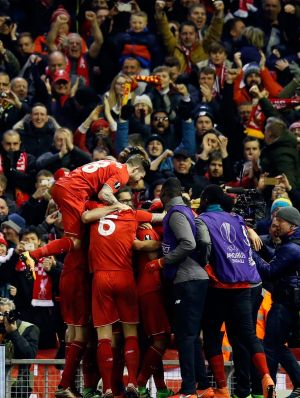 Liverpool players celebrate after Firmino's goal.