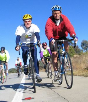 Steve Hodge rides into the NSW town of Gunning with then health minister Tony Abbott during the 2004 Pollie Pedal.