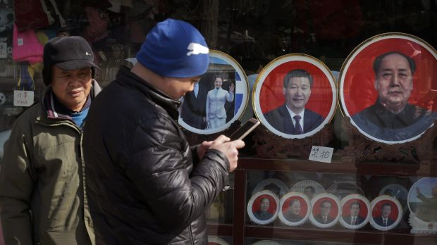 Souvenir plates bearing images of Chinese President Xi Jinping and former leaders including Mao Zedong at a shop near ...